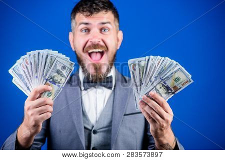 Being Flush Of Money. Rich Businessman With Us Dollars Banknotes. Currency Broker With Bundle Of Mon
