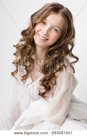 Portrait of smiling natural young woman