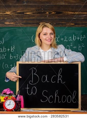 School. Home Schooling. Happy Woman. Teacher With Alarm Clock At Blackboard. Time. Study Education.