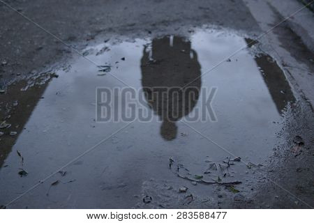Man Silhouette Reflected In Puddle Dark Reflection Ominous People