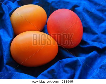 three painted easter eggs on the bright blue serviette poster