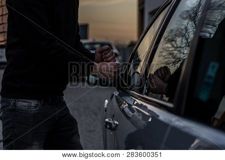 Car Thief Opening Stolen Car Doors