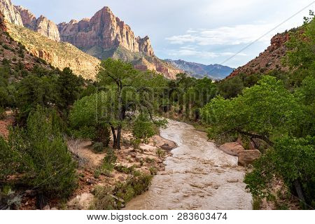 View Of The Watchman Rock Formation Along The Virgin River In Utah's Zion National Park At The Golde