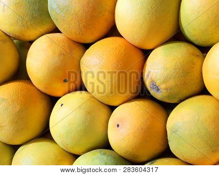 Background Of Many Big Organic Oranges For Sale At Local Market