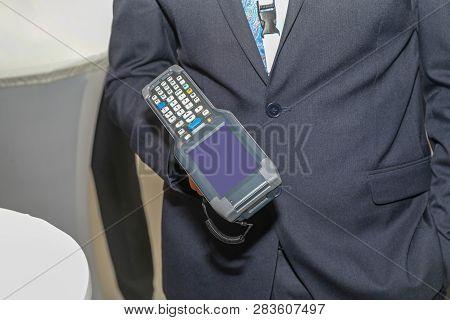 Man Holding Handheld Barcode Scanner Reader Portable Computer