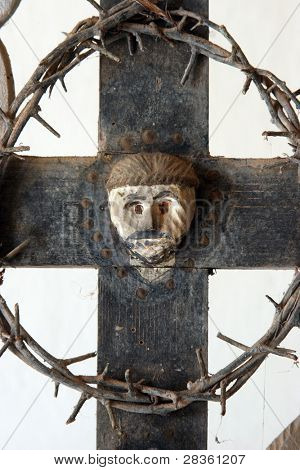 Christian cross with the symbols of the Passion of Jesus