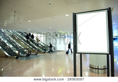 Black banner at airport with blured people