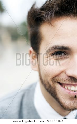 Young handsome man close portrait (piercing in his lips, easy to remove)