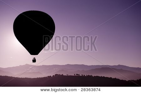 Hot air balloon flying over highest mountains in Spain.