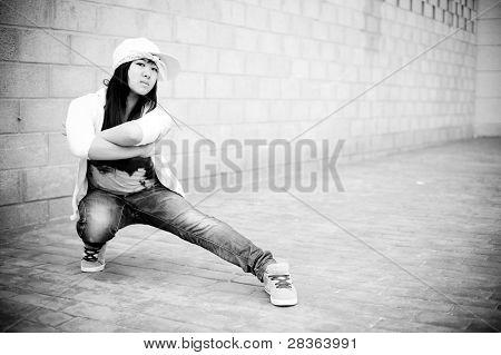 Beautiful asian girl in hip hop pose