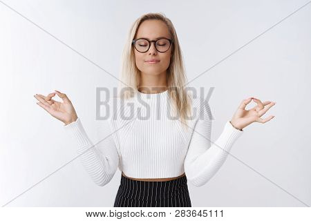 Female Entrepreneur Having Break Meditation To Release Negativity And Bad Emotions Practicing Yoga B