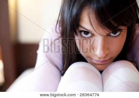 Young depressed girl staring at camera
