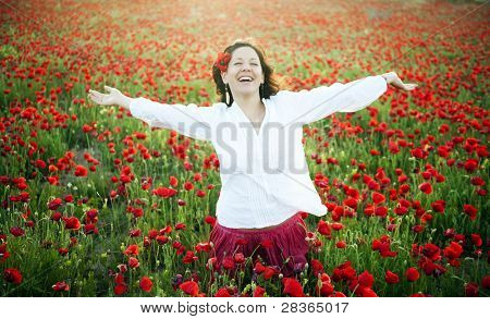 Young joyful woman in spring field