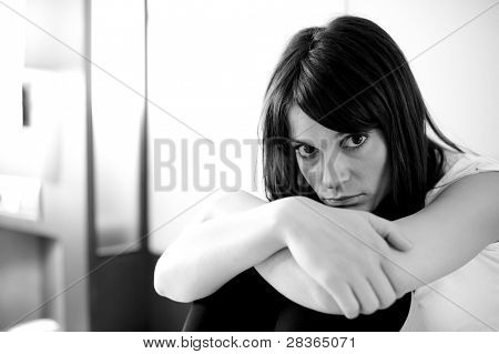 Young depressed woman staring at camera