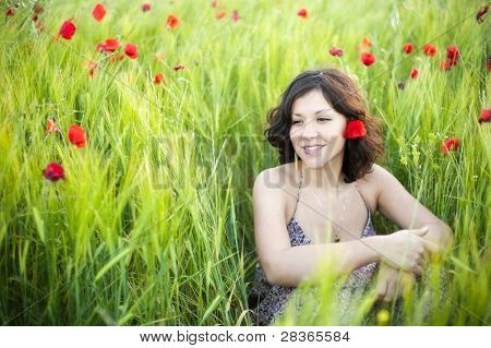 Young beautiful woman in spring field