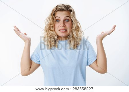 Yikes Sorry My Mistake. Portrait Of Awkward Apologizing Cute Unaware And Confused European Blond Fem