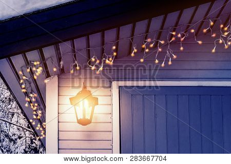 Porch Of The House Is Decorated In The Traditional Scandinavian Style With A Lantern And Christmas L