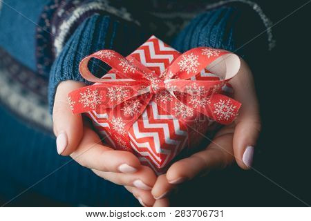 Close Up Shot Of Female Hands Holding A Small Gift