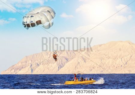 Air Parachute In The Sky. Water Parachute On Three Places. Parasailing. Summer Active