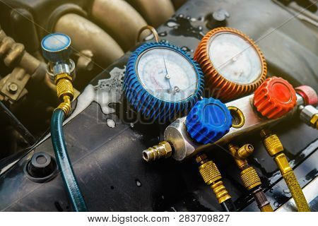 Mechanic Check Car Air Conditioner System In Garage