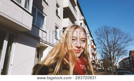 Authentic Urban Street Portrait Of Young Woman On A Sunny Day In Winter