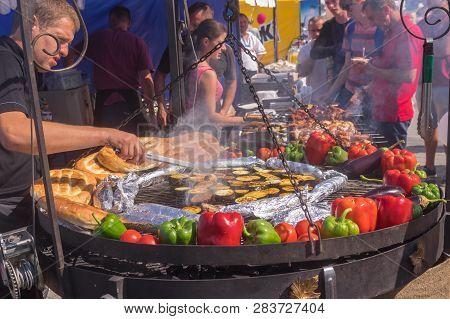 Dnipro, Ukraine - September 09, 2017: Man Cooking Egg-plants As Street Food On A Dripro River Embank