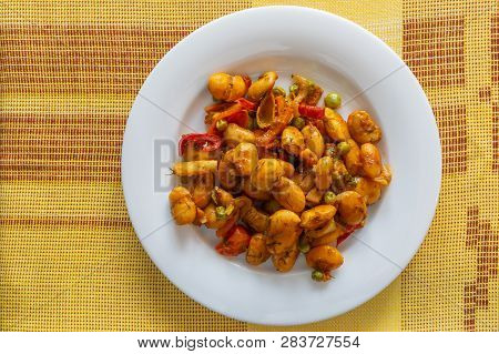 Top View On A White Plate With Beans Cooked With Vegetables