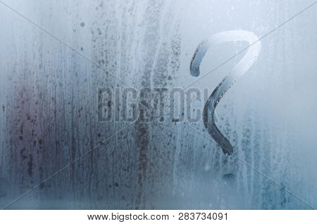 Drawn Question Mark On The Foggy Window. Water Droplets Condensation Background Of Dew On Glass, Hum