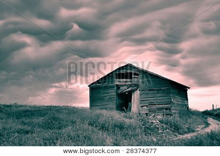 Rustic Barn With Stormy Sky