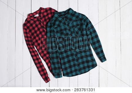 Fashion Clothes. Red And Green Checkered Shirt On White Wooden Floor Planks