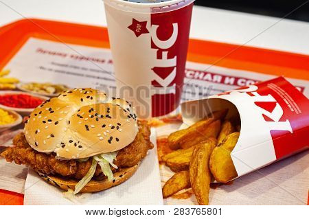 Minsk, Belarus, May 27, 2018: Sandwich, Potatoes And Paper Cup With Kfc Logo On A Tray In Kfc Restau