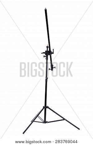 Lighting Strobe Stand On White Background. Tripod Light Stand For Studio Strobe And Lighting Fixture