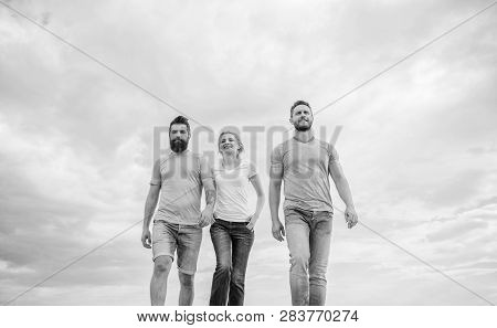 United Threesome True Friends. Men And Woman Walks Dramatic Cloudy Sky Background. True Friendship G