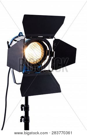 Professional Studio Lighting On White Background. Spotlight With Stand. Flashlight With Light Barn D