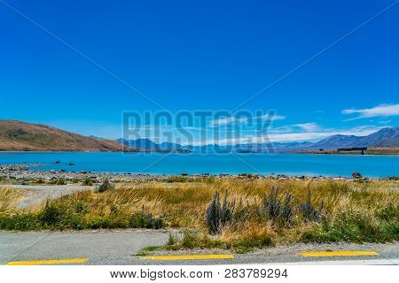 Beautiful Wide Look Over Lake Tekapo In New Zealand, Majestic Mountain Lake In New Zealand, Lake Tek