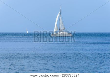 White Sailing Yacht Sailing In The Sea