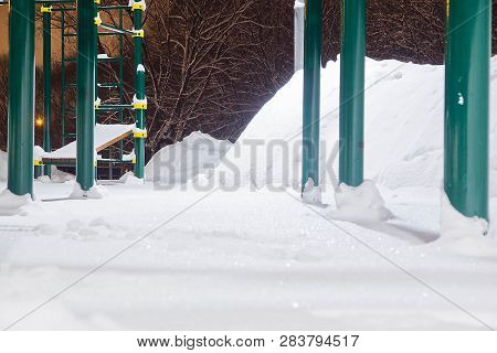 Playground In A Park In The Winter Evening