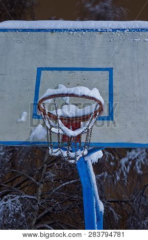Basketball Hoop Under Snow In A Park