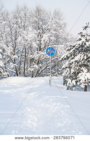 Road Sign And Trail In The Snow In Winter