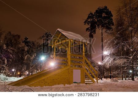 Playground In Winter City Park In The Evening