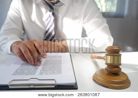 Legal Counsel Presents A Contract With Gavel And Legal Law. Justice And Lawyer Concept.