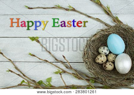 Easter Eggs, Nest And Branch With Leaves On Wooden Table Background. Top View. Copy Space For Text.