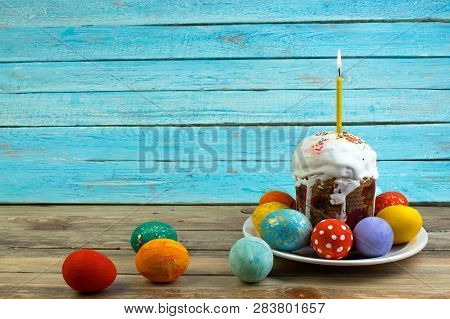 Happy Easter Card. Colorful Shiny Easter Eggs Cake With White Icing And Sugar Decor On The Table Dec
