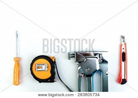 Drill, Putty Knife, Screwdrivers Construction Stapler On White Background. Tool. Top View.