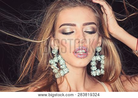 Fashion Model With Trendy Look. Glamour Jewelry Of Luxury Big Earrings. Girl With Sexy Lips Makeup.