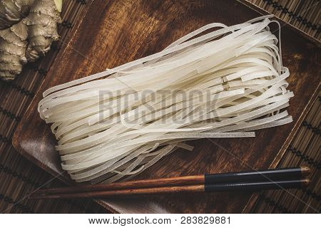Rice Noodles On A Rustic Wooden Board.