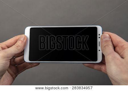 Mans Hands Holding Black Screen Mobile Phone
