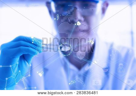 Young Attractive Male Scientist Holding A Red Transparent Pill With Futuristic Scientific Air Interf