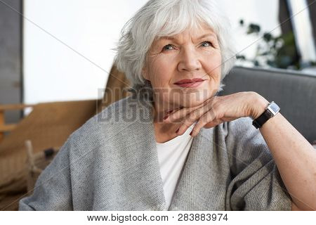 Elegance, Age, Beauty And People Concept. Indoor Image Of Charming Elegant Senior Mature Woman Enjoy