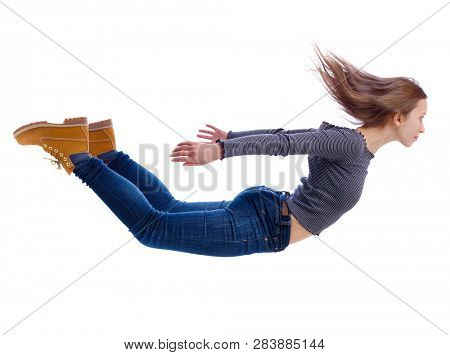 Side view of woman in zero gravity or a fall. girl is flying, falling or floating in the air. Side view people collection.  Isolated over white background. Girl flies down jumping from a helicopter.
